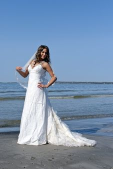 Free Bride Stands On The Beach Stock Photo - 19852370