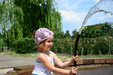 Little Girl With A Hose Royalty Free Stock Photo