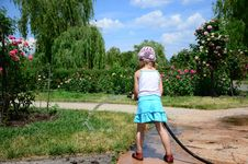 Little Girl With A Hose Royalty Free Stock Images