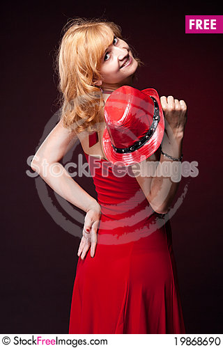 Free Red-haired Girl In A Red Dress And Red Hat Stock Photo - 19868690