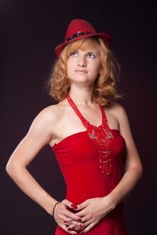 Red-haired Girl In A Red Dress And Red Hat Royalty Free Stock Photo