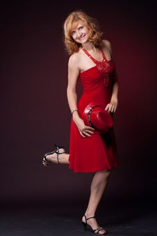 Red-haired Girl In A Red Dress And Red Hat Royalty Free Stock Photography