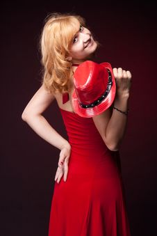 Red-haired Girl In A Red Dress And Red Hat Stock Photo