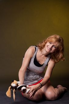 Red-haired Girl With Toys Stock Photography