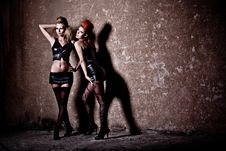 Free Women Wearing Corset And Posing On Wall Background Royalty Free Stock Photography - 19869927