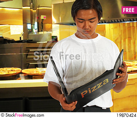 Free Diner Selecting Food From The Pizza Menu Stock Images - 19870424