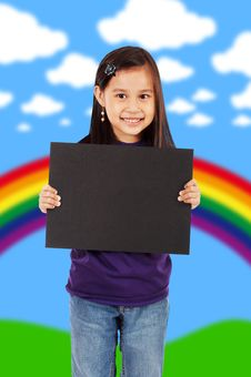 Free A Smiling Girl Holding A Blank Black Board Royalty Free Stock Photos - 19870308