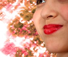 Free Smiling Girl With Sparkling Sunlight Background Royalty Free Stock Photo - 19870395