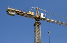Free Hoisting Crane On A Background Of Blue Sky Stock Images - 19870684