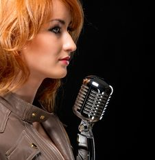 Free Beautiful Redhead Singer Royalty Free Stock Photography - 19872927