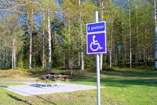 Bench In The Park And A Sign For Disabled Royalty Free Stock Photo