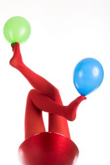 Free Female Feet In Red Stockings With Balloons Stock Images - 19875354