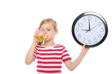 Free Girl With Clock Drinking Juice From Glass Stock Photo - 19876070