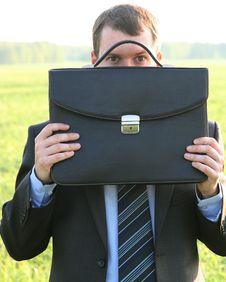 Free Businessman Closes Black Briefcase Stock Image - 19879731