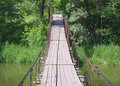 Free Old Suspension Walk Bridge Across River In Forest Stock Photo - 19883460