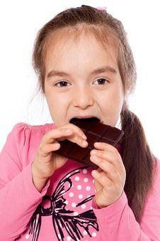 Free Girl Eating Chocolate Royalty Free Stock Image - 19881396
