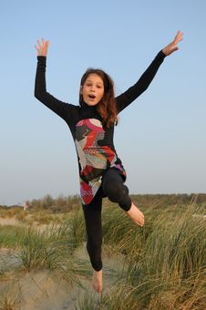 Free Young Girl Jumping For Joy Royalty Free Stock Photo - 19884515