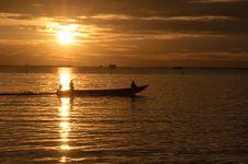 Fishermen Boat In Sunset Stock Photo