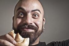 Free Happy Man With Bread In His Mouth Stock Photos - 19894303
