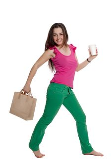 Beautiful Girl With A Bag And A Coffee Cup Is Walk Stock Photo