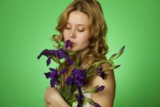 Attractive Girl Hugging A Bouquet Of Irises Royalty Free Stock Image