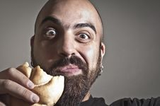 Free Man With Bread In His Mouth Royalty Free Stock Photography - 19896737