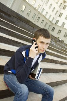Modern Student Talking On A Mobile Phone Royalty Free Stock Image