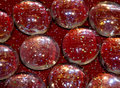 Free Glass Pebbles On Red Sparkle Stock Photo - 19906390