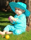 Free Toddler Sitting On Grass Playing With Colored Ball Stock Photos - 19907283