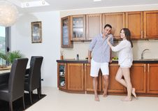 Free Happy Young Couple Have Fun In Modern Kitchen Stock Images - 19900434