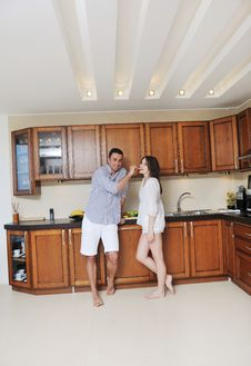 Free Happy Young Couple Have Fun In Modern Kitchen Stock Image - 19900861