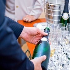 Free Man In Suite Pouring Champagne To Glasses Royalty Free Stock Images - 19902639