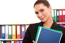 Free Business Woman In Front Of Shelves With Folders Royalty Free Stock Images - 19902749