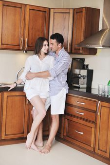 Free Happy Young Couple Have Fun In Modern Kitchen Stock Images - 19903074