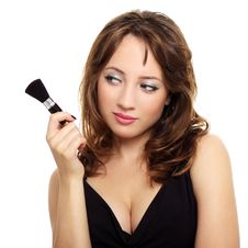 Free An Attractive Young Lady With Makeup Brush Stock Images - 19909034