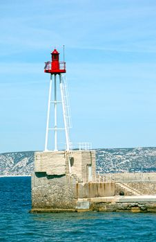 Free Light Beacon At The Entrance Of A Harbor Stock Photo - 19909160