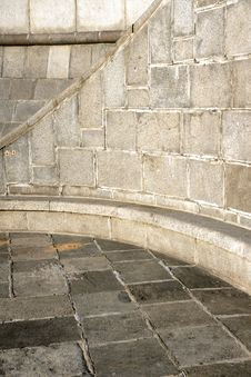 Curve Section Of A Granite Stone Wall And Floor