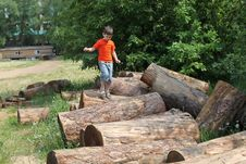Free Boy Jumping Over Logs Stock Photo - 19911940