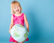 Free A Little Girl With A Globe Royalty Free Stock Photos - 19912158