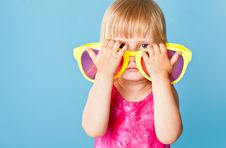 Free A Little Girl With A Huge Sunglasses Stock Photography - 19912162