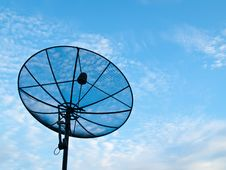 Satellite Dish On A Blue Sky And Cloud Background Royalty Free Stock Photos