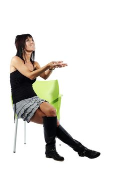 Attractive Woman Gesturing To Her Left Sitting Dow Royalty Free Stock Photography