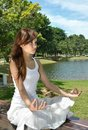 Free Young Girl Meditating In The Park Royalty Free Stock Image - 19926816