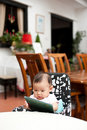 Free 7 Month Old Asian Baby Girl Reading Lunch Menu Stock Photo - 19927920