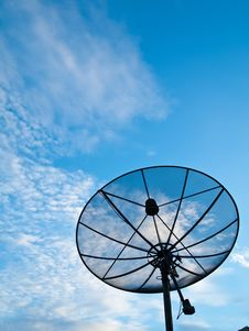 Satellite Dish With Blue Sky On The Background Stock Photo