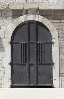 Free Large Metallic Door And Stone Wall Royalty Free Stock Photo - 19921625