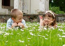 Free Girl And Boy Lying On The Grass Royalty Free Stock Photos - 19924088