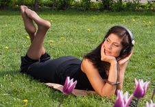 Dreaming  Brunette Rest  On The Grass Royalty Free Stock Images