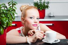 Free Girl With Cup Of Morning Coffee In Interior Of Kit Royalty Free Stock Photo - 19926625