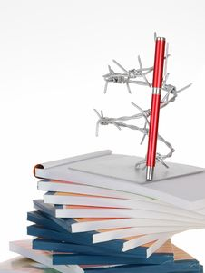 The Barbed Wire And A Pen On Note Book Stack Stock Photos